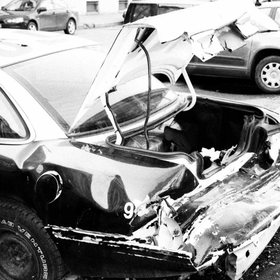 the car is (was) crashed / the car crashed into something
